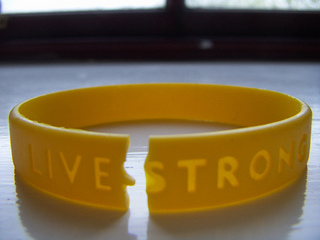 Broken promises from Lance Armstrong represented in this broken bracelet